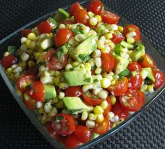 My absolute favorite summer BBQ salad. Grilled corn, avocado + tomato with spicy honey lime dressing