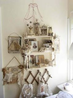 A small shelf and peg create a centerpiece for an artistic montage.
