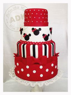 Red Minnie Mouse Cake.... maybe mickey it up of Ti?