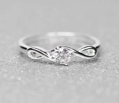 - Metal Material: .925 Sterling Silver - Average Weight: 1.67gm Width:1 mm Band Stone Type: Cubic Zirconia (CZ) Stone Creation Method:Synthetic Stone Treatment:Synthetic Stone Color:White