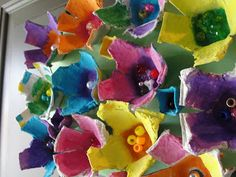 Bright and colorful Egg Carton flowers for spring! These crafts can decorate the classroom into Summer, and are the perfect way to recycle all the extra cartons from egg activities for Easter