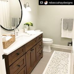 #Repost Rebecca Hay Designs (@get_repost)  ・・・  Before & After of the guest bath at #projectcampbellville. We relocated the door to this bathroom and move the toilet to the other end. Two sinks was overload for this rarely used guest bath so we opted for one sink and a fantastic large round mirror. The floor tile detail is my favourite part .  .  #countryhouse #bathroom #bathroomdesign #bathroomreno #interiordesign #rebeccahaydesigns #quartzcountertops #woodvanity