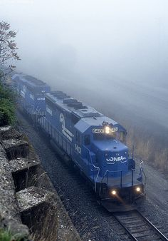 CR 6401 leads a UFS coal train on the Port Perry Branch on the foggy morning of October 15, 1997.