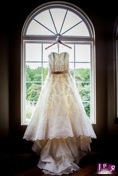 """The bride was in a Pronovias """"UCEDA"""" gown from Jennifer's Bridal in Hockessin, DE and Kate Spade heels."""