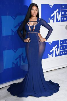 Strike a pose: Nicki Minaj put on a truly jaw-dropping show in a purple cut-out…