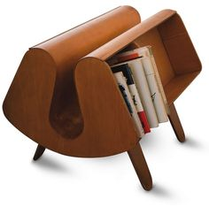 It was designed in 1939 by Jack Pritchard and Egon Riss for Isokon. The Donkey was called that because of its four legs and two panniers on either side. It turned out that the side shelves were exactly the right size for the new paperback books being published by Penguin, so the publisher put leaflets for the Donkey inside the books, which was then renamed the Penguin Donkey.