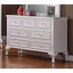 The youthful Isabella Collection is as smart as it is stylish, with lots of extra storage options and a clean, airy look. The Isabella Dresser is constructed from solid pine, MDF and hardwood veneers with a white finish and crystal-look knobs. The dresser's seven spacious drawers feature center guided wood on wood drawer glides, solid wood framing, felt lining in the top three drawers and protective dust proofing in the bottom drawers.