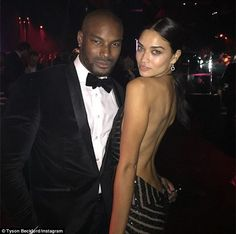 Cuddling up: The male model posted a shot of the pair together, with Shanina pressing up a...
