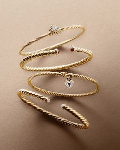 Cable bracelets in 18k gold with gemstones or diamonds.