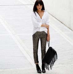 Style Heroine Is Wearing Boots From Saint Laurent, Bag From Valentino, Bespoke Shirt, Sequin Trousers From Isabel Marant