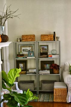 Style your shelving - large baskets on the bottom are great to keep kids toys where they can reach them.
