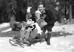 This adorable family portrait of Walt Disney, his wife Lillian, and their cute child, Mickey.