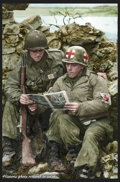 An American Medic and a GI of the US. Infantry Division reading a comic at Reisdorf in Luxembourg near the German Border. of February 1945 Left to right : Pfc Reynold H. Bush Middletown, Ohio , and Pfc Aurelio Maltese, New York, pin by Paolo Marzioli Army Medic, Combat Medic, Military Art, Military History, Military Deployment, Military Drawings, War Photography, American Soldiers, Historical Pictures