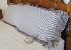 listing is for ) Body pillow covermeasurements.( L x wide )has a ruffle around whole pillow overlap closure in back covers the bed linen / tickingregular wash / tumble dry