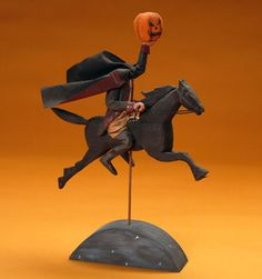 Headless Horseman Ltd. Ed. ~The headless Hessian figure rides through the night with his cape flying behind him and a jack 'o' lantern held high.