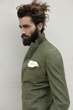 Mrow. Hair insanity, lovely beard, AND a suit coat with pocket square? Yes, I'll take two to go, please and thank you.