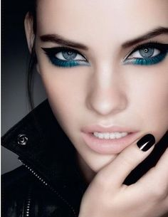 Graphic blue winged liner.