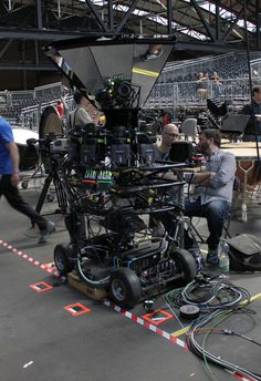 "An insane setup - the reduced in size ARRI ALEXA ""M"" on a dolly rig with mirrors that makes the top-level camera Panorama-ready"