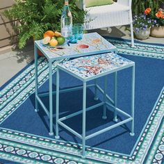 Featuring incricate mosaic-inspired nautical designs, these outdoor nesting tables are a great way to add fin-spiration to your outdoor decor.