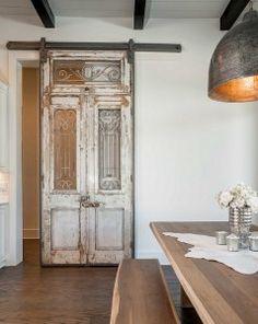 Antique Sliding Barn Door Dining/Kitchen. Copper Dining room Light. Farmstyle interior design.