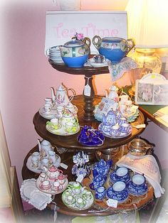 Tea Time Table- Miniature tea sets and other tea items on a vintage three tiered table.