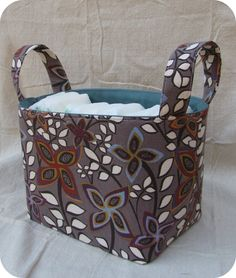 Fabric Organizer Bin from Rad Crafter. I think this is one of my favorite bin tutorials, because she includes a cutting template. Also love her handle technique.