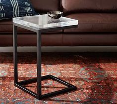 the table is great but that RUG!!! - Barton Acrylic C-Table Side Table #potterybarn
