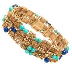 Mid Century Gem Set Gold Link Bracelet | From a unique collection of vintage link bracelets at https://www.1stdibs.com/jewelry/bracelets/link-bracelets/