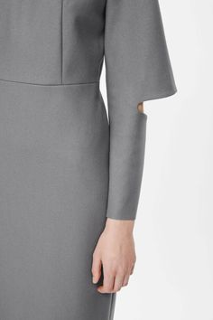 COS image 4 of Cut-out sleeve fitted dress in Light Grey