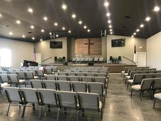 Cross is up front & featured,rest of wall complement cross section. hard flooring and stage flooring is wood color of cross or darker Church Interior Design, Church Stage Design, Lobby Interior, Church Lobby, Church Foyer, Church Welcome Center, Auditorium Design, Church Backgrounds, Modern Church