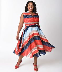 Your timing is just inborn, dears! Bursting with plus size vintage charm and class comes the De Carlo Swing Dress from Unique Vintage. Cast in a marvelous chiffon of multiple red and blue stripes printed throughout, this gorgeous sleeveless silhouette has