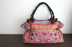 tote - looks like Hmong Hill Tribes' embroidery.  Whatever it is, I love it.