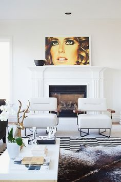 Luxuriate in the Living Room. White and fab. Pop art.