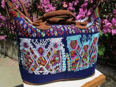 The beautiful blue Chajul weekender bag is back!  Deep blue Guatemalan textile from Chajul, Quiche with quality suede finishes.:
