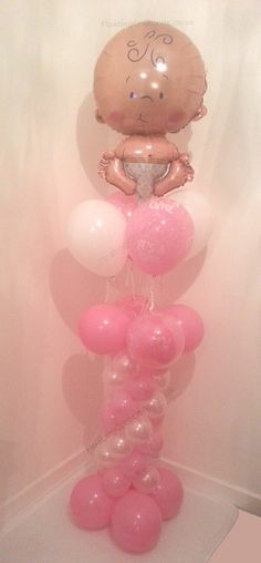 Baby Girl Balloon Column. Helium filled with four helium filled latex balloons attached to a matching column.    The column features double bubble 'it's a girl' balloons . Very pretty display that stands 77 inches tall. https://www.facebook.com/balloonsglasgow