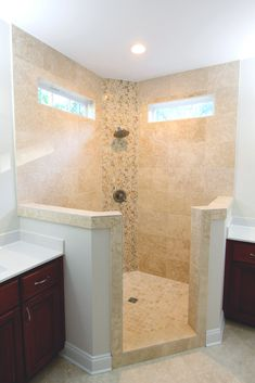 Custom walk-in corner shower with floor to ceiling tile and separate vanities #bathroom #shower #remodeling ©Balducci Builders, Inc.