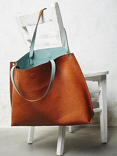 Slouchy Vegan Tote | This reversible, carry-everything vegan leather tote features an elegant shape and large removable zipper pouch. Magnetic snap closure. Weekend antique jaunts here I come.