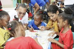 Jamaica Gleaner Gallery | Crayons Count! |  Crayons Count held the Official event to mark the first annual Children's Day in Jamaica. Christopher Barnes, managing director of The Gleaner Company and Lisa Hanna, minister of youth and culture interact with children from basic schools downtown Kingston, during an After school event for children from basic schools chosen by the national child month committee from Downtown Kingston. held at the Gleaner's parking lot along East street.