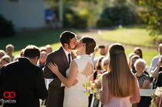 Elizabeth + Patrick's Wedding at Lenora's Legacy. Photo credit: Cureton Photography First kiss