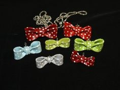 Polymer clay bows. They come in different sizes. They're plain or polka dotted. Can be worn with chains, organza ribbon necklaces or added to other jewelry.  Each is a one-of-a-kind and handmade in the U.S.A.