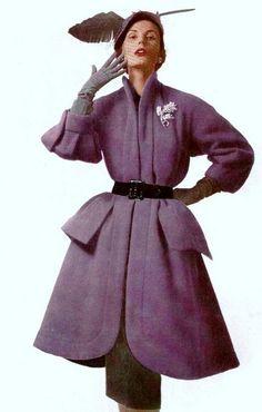 Model wearing a purple woolen coat by Jacques Fath, 1950. Photo by Philippe Pottier