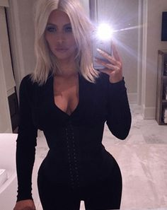 Kim Kardashian showed off her insanely tiny waist in a bedtime selfie on Monday, March 16, as she did some household chores whilst waist training in a corset