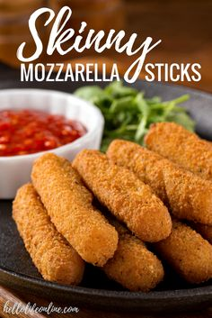 Skinny Mozzarella Sticks-This recipe for homemade Skinny Mozzarella Sticks isn't just easy to make, but a deliciously healthy alternative to traditional fried cheese sticks. You'll never guess that they're baked!