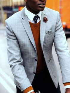 Classy blazer and sweater combo with a pop of color.