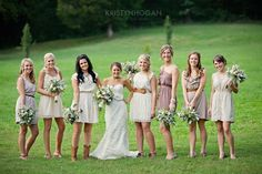 Love this miss matched bridesmaid, the browns and the wedding dress. oh and the flowers. all around love!