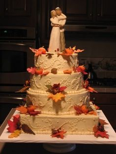 This cake was made for a Fall wedding.  Leaves, acorns, pumpkins  berries were all made using fondant/gumpaste.  Leaves were colored with petal dust.   Icing is buttercream.