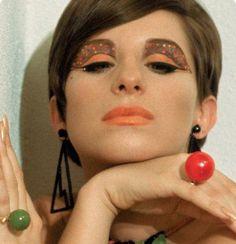 A #60s Barbra Streisand. Orange jeweled eyes & orange lips. Love it!