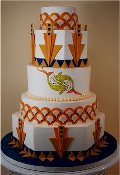 We made this Wedding Cake this past weekend for a bride having her reception at the local art museum.  It's not often that we find a couple willing to be so bold with their wedding cake design.  We had a blast making it.  It's a buttercream covered cake with modeling chocolate accents.  The koi fish were printed on edible image paper.