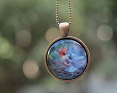 Girls Wearable Art Necklace, magical Flower Fairy jewelry for children and adults - woodland inspired pendant. $20.00, via Etsy.