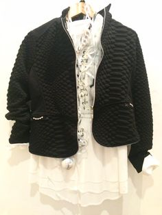 Elisa Cavaletti whit shirt with black & white pattern with a little sparkle £175.95. Elisa Cavaletti short black jacket £220. Tutti&Co leather strap necklace with antique silver links £45.